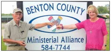 Leroy Uptain of the Johnsonville TVARA presents a check to Sylvia Newman of the Benton County Ministerial Alliance, which operates a food pantry.